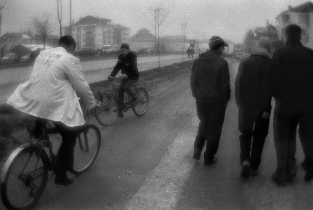 Cyclists and teenagers near the road in Düzce town. Turkey, 07