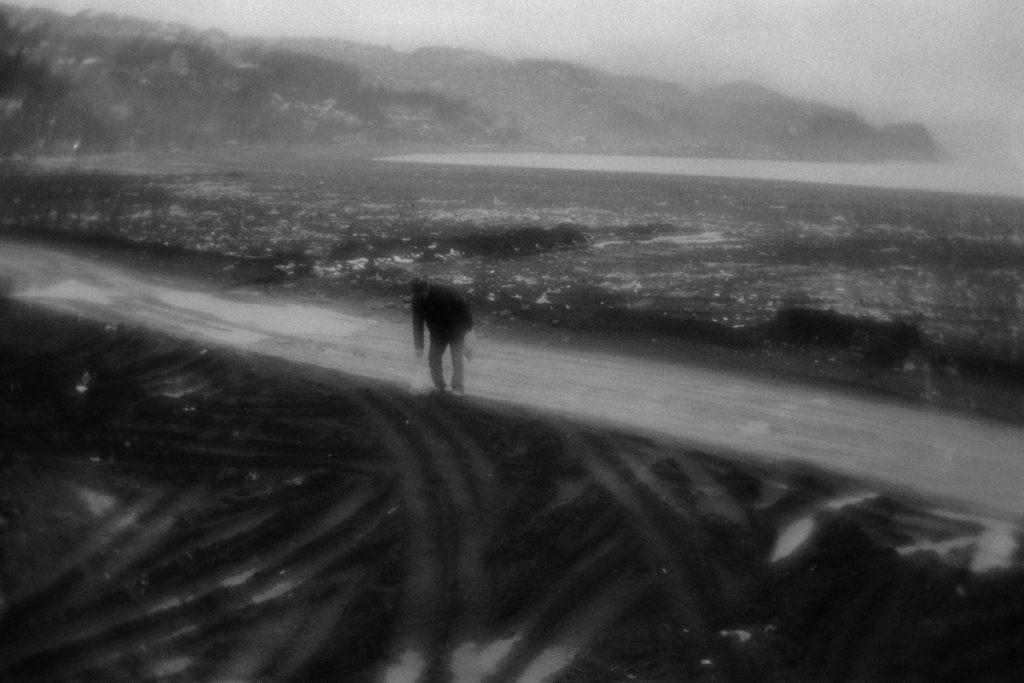 Man is gathering the coal on the beach near Zonguldak. Coal is u