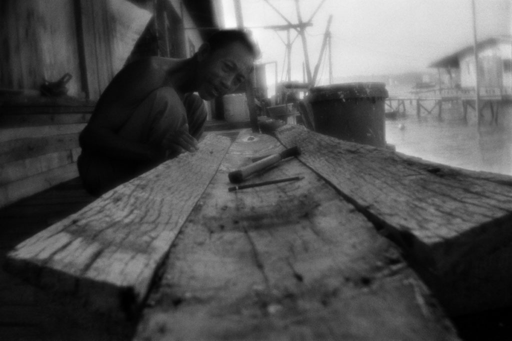 Constructing the boat. The settlement of Sea Gypsies on the Gaya