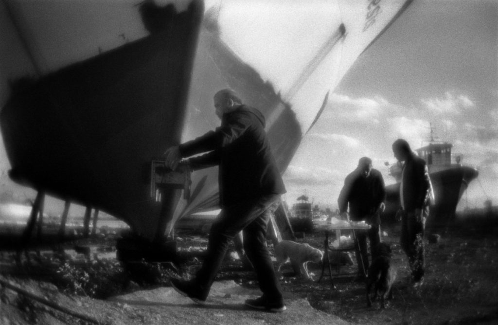 Picniс on the Black sea shore  among the ships parked on the ke